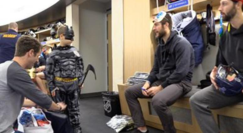 Alex Pietrangelo hand candy out to kids in the St. Louis Blues locker room