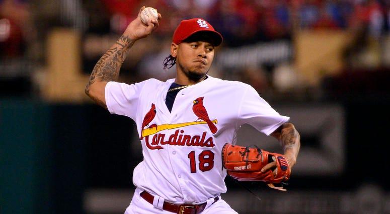 St. Louis Cardinals starting pitcher Carlos Martinez (18) pitches