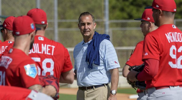 Feb 15, 2018; Jupiter, FL, USA; St. Louis Cardinals general manager John Mozeliak watches workout drill at Roger Dean Chevrolet Stadium. Credit: Steve Mitchell-USA TODAY Sports