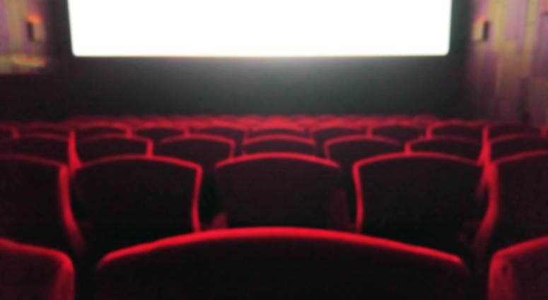 Blur Movie Theater with Red Chairs