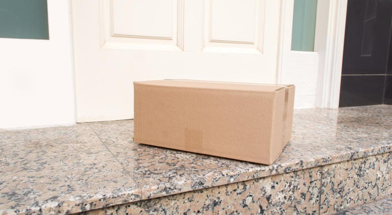 Carton box on the floor of entry of the house