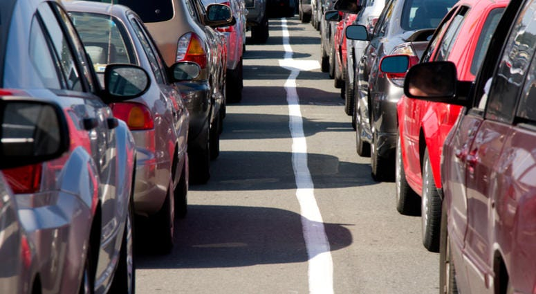 Traffic line up of cars waiting to board ferry