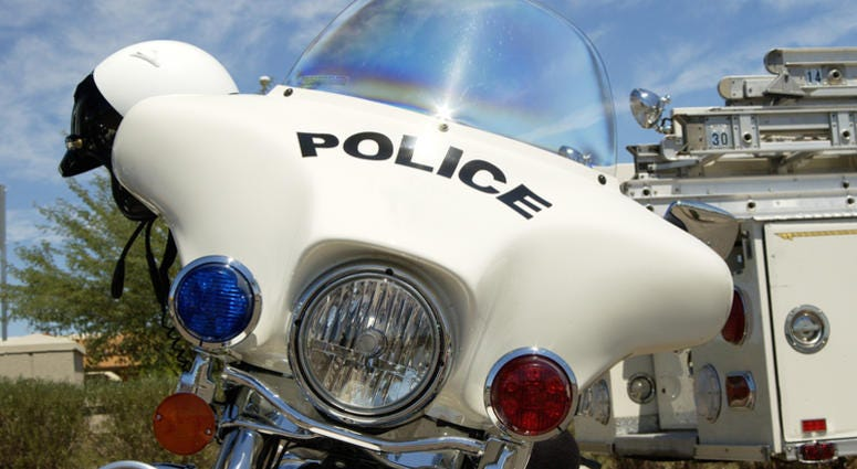 Police motorcycle on display at a fundraising event.