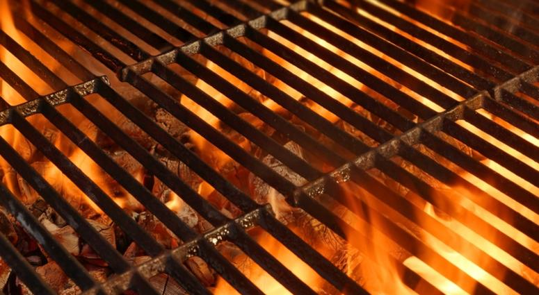 BBQ Grill with Glowing Coals and Bright Flames