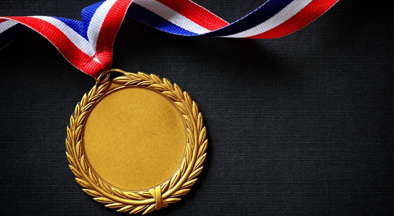 olympic looking gold medal