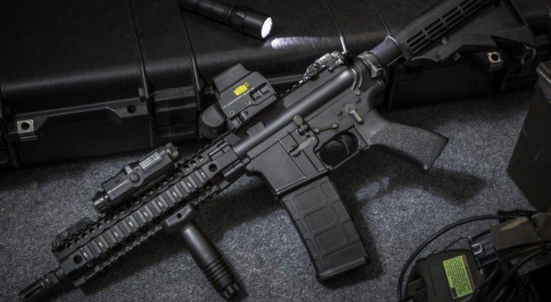 Assault rifle AR15 and flashlight