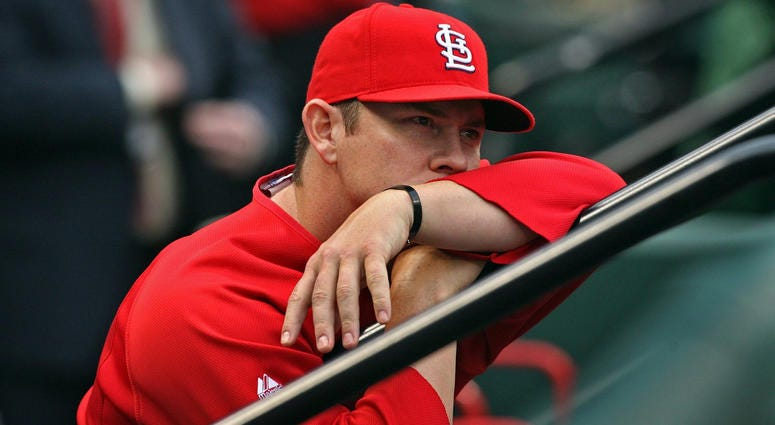 Jason Isringhausen in the dugout with the St. Louis Cardinals