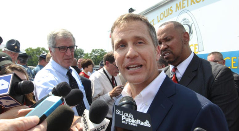 Missouri Governor Eric Greitens talks with reporters after introducing a new program that will deal with the violence problem in St. Louis during a press conference in St. Louis on July 10, 2017.