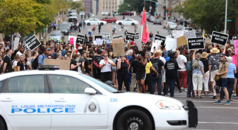 Police block the streets for protesters during a peaceful protest outside of St. Louis Metropolitian Police Headquarters in St. Louis on September 17, 2017.