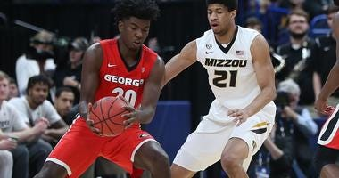 Jordan Barnett (#21) playing in the SEC Tournament in St. Louis (Bill Greenblatt/ UPI)
