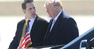 U.S. Senate hopeful, Missouri Attorney General, Josh Hawley talks with U.S. President Donald Trump after the President's arrival at St. Louis-Lambert International Airport in St. Louis on March 14, 2018. Trump is in St. Louis for a roundtable meeting with