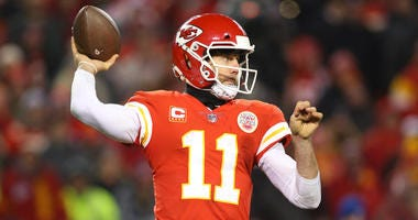 Kansas City Chiefs quarterback Alex Smith throws a pass