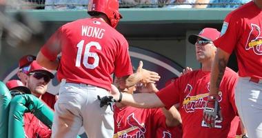 St. Louis Cardinals second baseman Kolten Wong (16) is congratulated by St. Louis Cardinals manager Mike Matheny