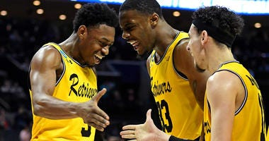 UMBC Retrievers players celebrate.