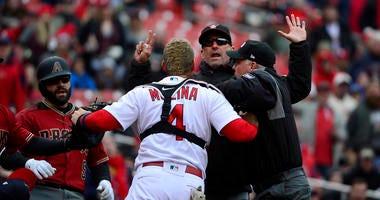 Catcher Yadier Molina yells at the Diamondbacks manager.