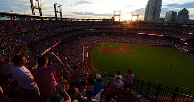 Fans celebrate as the sun sets after a solo home run by St. Louis Cardinals