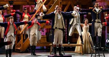 Lin-Manuel Miranda (center) and the cast of 'Hamilton'
