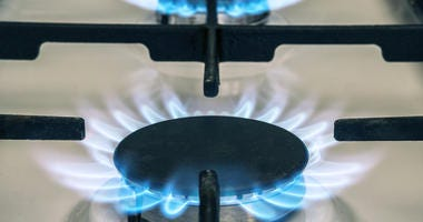 Gas stove flame on kitchen. Blue fire flame from stove.