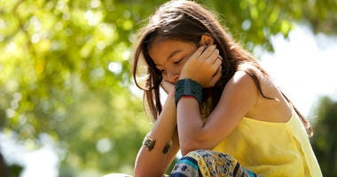 Young child at the park with a depression