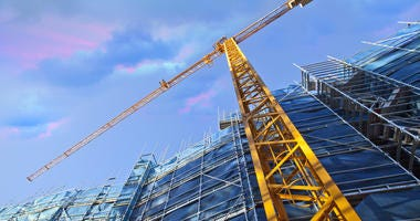 Yellow construction crane on building site