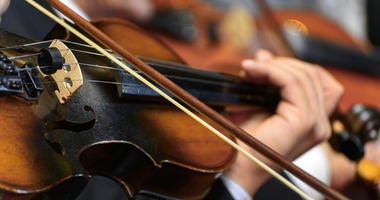 Closeup of Musician Playing The Violin During a Symphony