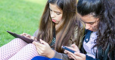 Young girls having fun posting on social media
