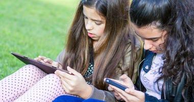 Young girls having fun posting on social media