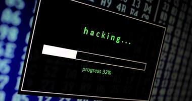a computer screen shows a hacking progress bar