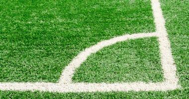 White corner field line on artificial green grass of soccer field,Artificial turf football field