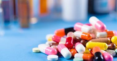 a pile of colorful prescription drugs
