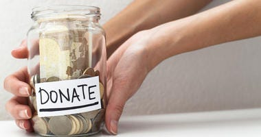 Donate note on a money jar donation concept