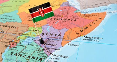 Kenya paper flag pin on a map, exotic travel concept