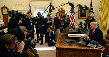 President Donald Trump makes remarks to the press after signing the $1.5 trillion tax cut bill in the Oval Office