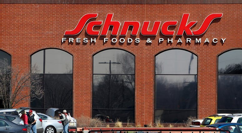 Customers shop at Schunks grocery store on Friday, March 29, 2013, in Kirkwood, Missouri.