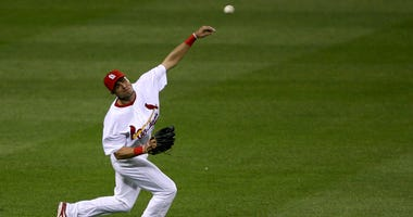 St. Louis Cardinals outfielder Rick Ankiel throws to the diamond after fielding a ball