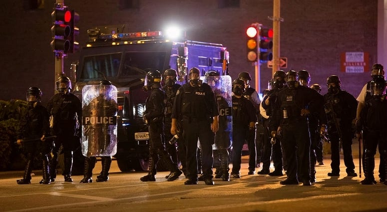 Police officers stand guard in St. Louis, Missouri, the United States, Sept. 17, 2017. Protesters smashed windows and other property in downtown St. Louis, Missouri Sunday night.
