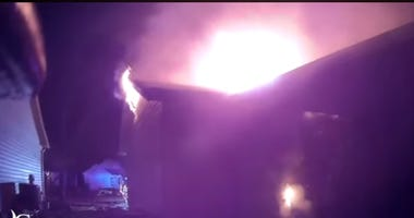 A still shot from a helmet cam shows an attic fire on Plum Leaf Circle