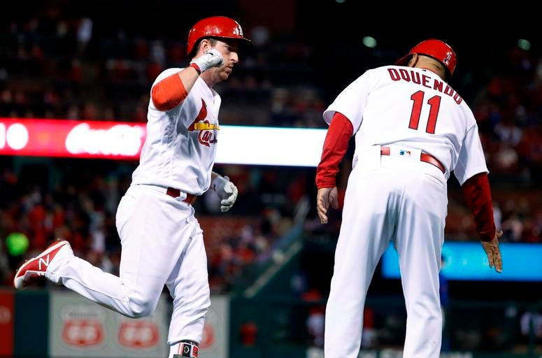 St. Louis Cardinals' Jedd Gyorko, left, is congratulated by third base coach Jose Oquendo after hitting a solo home run