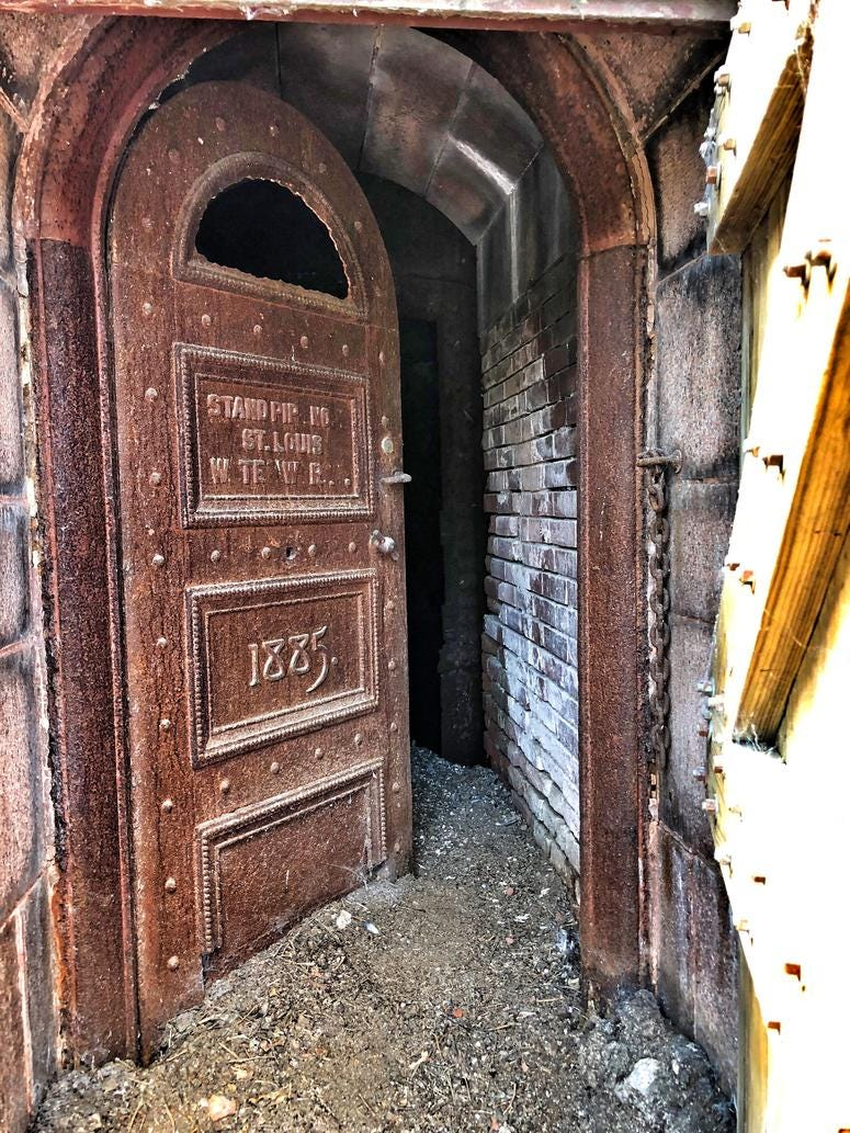 """Entry door to """"Red Tower."""" Hidden by a wood door for years, you can see the pigeon droppings and debris of the years at door's base. Photo by D. Monterrey"""