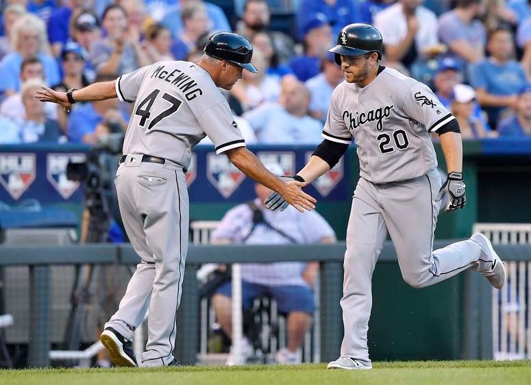 Chicago White Sox third baseman Todd Frazier (right) celebrates his two run home run with third base coach Joe McEwing