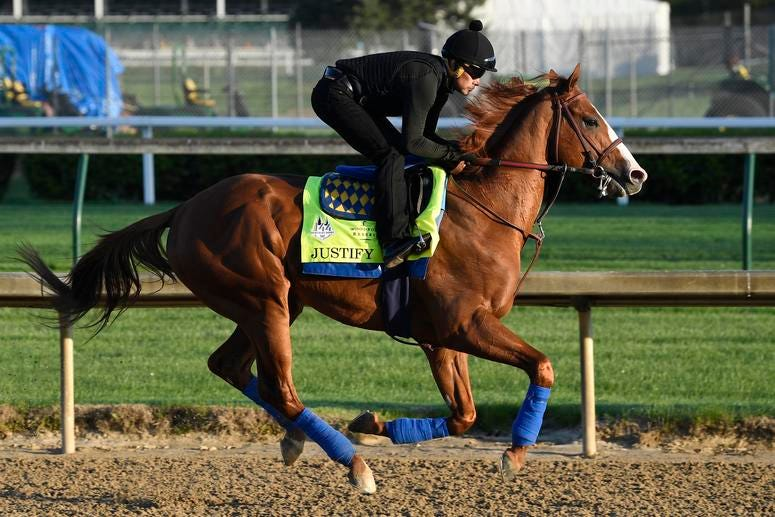 An exercise rider works out Kentucky Derby hopeful Justify at Churchill Downs.