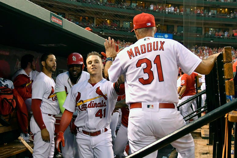 St. Louis Cardinals right fielder Tyler O'Neill (41) is congratulated by pitching coach Mike Maddux.