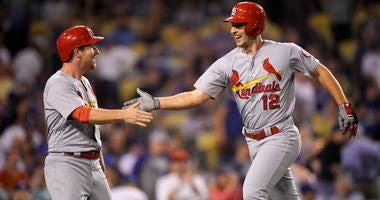 St. Louis Cardinals' Paul DeJong, right, is congratulated by Jedd Gyorko after hitting a two-run home run during the ninth inning
