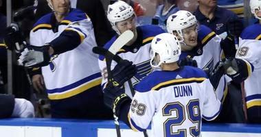 St. Louis Blues defenseman Vince Dunn (29) is congratulated after scoring the game-winning goal