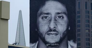 A large billboard stands on top of a Nike store showing former San Francisco 49ers quarterback Colin Kaepernick at Union Square.