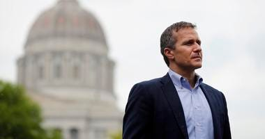 Missouri Gov. Eric Greitens stands off to the side before stepping up to the podium to deliver remarks to a small group of supporters near the capitol announcing the release of funds for the state's biodiesel program in Jefferson City, Mo.