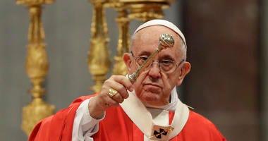 Pope Francis asperges holy water as he celebrates a Pentecost mass in St. Peter's Basilica, at the Vatican, Sunday, May 20, 2018.
