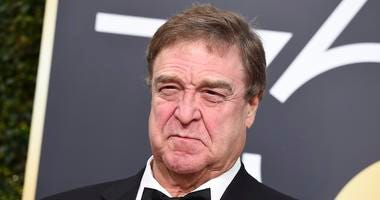 John Goodman arrives at the 75th annual Golden Globe Awards at the Beverly Hilton Hotel in Beverly Hills, Calif.