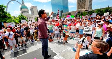 In this June 30, 2018, photo, Wesley Bell, a candidate for St. Louis County Prosecuting Attorney, addresses the crowd during a protest about the Trump Administration's policy of family separation and detention at Kiener Plaza in downtown St. Louis. St. Lo