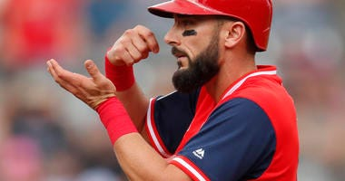 St. Louis Cardinals' Matt Carpenter gestures to the dugout